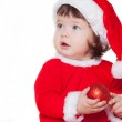 Christmas happy baby in Santa hat playing with balls. Isolated on white background. — Stock Photo #17020567