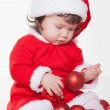 Christmas happy baby in Santa hat playing with balls. Isolated on white background. — Stock Photo #17020587