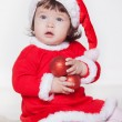 Christmas happy baby in Santa hat playing with balls. Isolated on white background. — Stock Photo #17020717