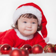 Christmas happy baby in Santa hat playing with balls. Isolated on white background. — Stock Photo #17020791