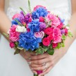 Stock Photo: Beautiful wedding bouquet in hands of bride