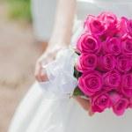 Beautiful wedding bouquet in hands of the bride — Stock Photo #33410975
