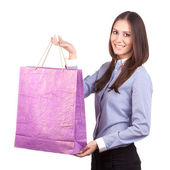 Portrait of young happy smiling woman with shopping bags, isolat — Stockfoto