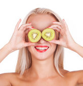 Kiwi. Healthy fruit funny woman holding kiwi fruit for her eyes. — Stock Photo