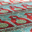 Mosque prayer carpet — Stock Photo #13129304