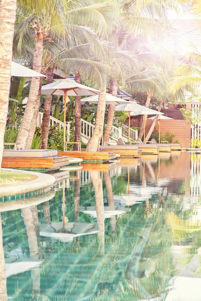 Image of a luxury holiday resort with poolside loungers. Thailand, Asia. — Stock Photo #13129299