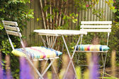 Cozy garden seating area — Stock Photo