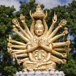 Golden buddha with many arms — Stock Photo