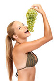 Portrait of a funny woman with grape — Stock Photo