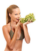 Portrait of a healthy woman with grape — Stock Photo