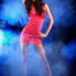 Fashion shooting in dark studio — Stock Photo