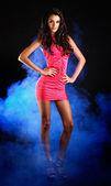 Beautiful brunette lady posing on dark background — Stock Photo
