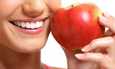 Healthy teeth and red apple — Stock Photo