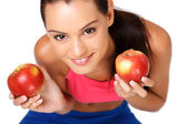 Closeup portrait of a brunette teenager with apples — Stock Photo