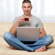 Guy with laptop and tea — Stock Photo #4600516