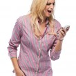 Angry woman yelling into phone — Stock Photo #8318664