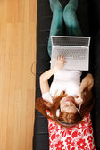 Young Redhead Girl surfing on the Sofa — Stock Photo