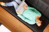 Surfing on the Sofa — Stock Photo