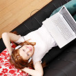 Young Redhead Girl surfing on the Sofa — Stock Photo #20019291