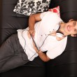 Young man with a Tablet PC and Headphones on the Sofa — Stock Photo