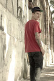 Rapper leaning on a Wall — Stock Photo