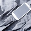 Smartphone on a shirt — Stock Photo #32177495