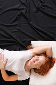 A young woman in bed — Stock Photo