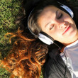 Cheerful in the Park listening music — Photo