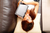 Young woman showing a Tablet PC — Stock Photo