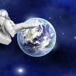 Astronaut floating far from Earth — Stock Photo