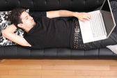 On the Sofa with a Laptop — Stock Photo