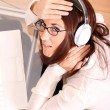 Woman with a Laptop and Headphones — Stock Photo