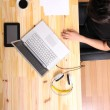 Working on a wooden Desk — Stock Photo