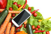 Vegetables and a Smartphone			 — Stock Photo