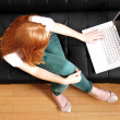 Young Redhead Girl with a Laptop — Stock Photo