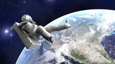 Astronaut floating over the Earth — Stock Photo