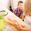 Mother and Son having breakfast at home — Stock Photo #47635425