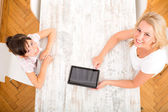 Mother and Daughter with a Tablet PC	 — Stockfoto