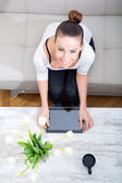 Young woman with a Tablet PC on the Sofa — Stock Photo