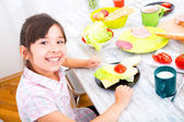 Little girl having breakfast at home — Stock Photo