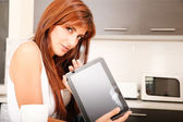 Young woman with a Tablet PC in the Kitchen	 — Foto Stock