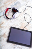 Tablet PC and headphones	 — Stock Photo
