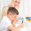 Mother and son doing homework — Stock Photo
