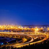 Overpass bridge and pier in night — 图库照片
