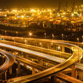 Overpass bridge and pier in night — Stock Photo