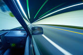 Fast cars in tunnel — Stock Photo