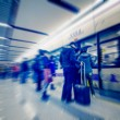 Stock Photo: Passengers motion blur