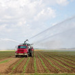 Irrigation of farmland to ensure the quality of the crop — Stock Photo