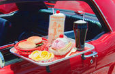 Close up of a vintage drive-in food tray with burger, fries and a soda — Stock Photo