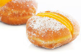 Two Berliner with egg creme over white — Stock Photo